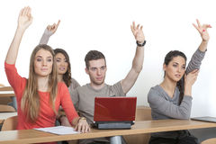 Students put up their hands Royalty Free Stock Photography