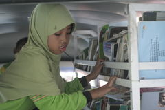 Students queuing up to read a book in the mobile library Stock Photo