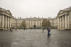 Students in the rain on Trinity college in Dubln stock image