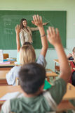 Students Raising Hands in a Maths Lesson Royalty Free Stock Image