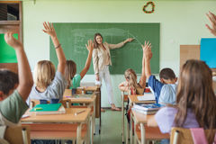 Students Raising Hands in a Maths Lesson royalty free stock photo