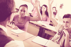 Students raising their hands up Royalty Free Stock Image