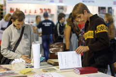 Students read the books at the book fair. People choose the books at the Second International Festival BOOK ARSENAL on October 7, 2012 in Kiev, Ukraine. The Stock Photography