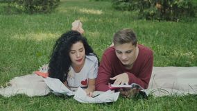 Students read synopses, preparing to exams in park stock video