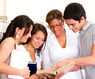 Students reading a book Royalty Free Stock Image