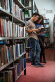 Students reading book in library Stock Photos