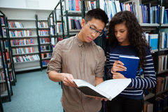 Students reading book in library Stock Images