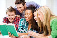 Students reading book at school Royalty Free Stock Images