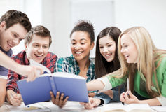 Students reading book at school stock photography