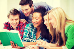 Students reading book at school Stock Photo