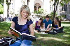 Students reading books Stock Images