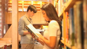 Students reading books stock footage