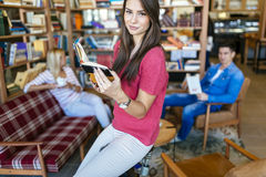 Students reading books in library Royalty Free Stock Photo