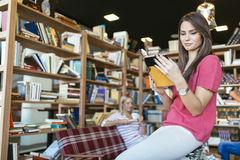 Students reading books in library Stock Photo