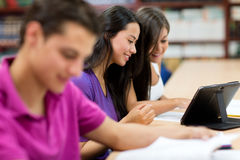 Students reading on an e-book Stock Image