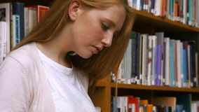 Students reading in a library stock video footage