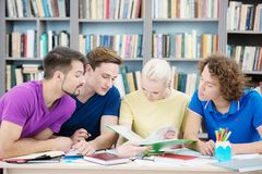 Students reading new information in classroom Royalty Free Stock Images