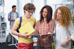 Students reading over their class notes. At the college Royalty Free Stock Photos