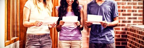 Students reading papers. In corridor Stock Images