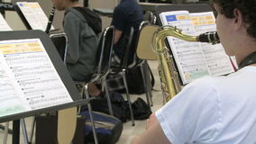 Students reading sheet music in class. A view or scene of School stock video
