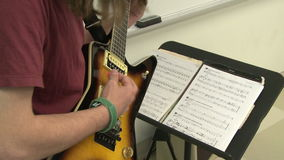 Students reading sheet music in class (9 of 9). A view or scene of School stock video footage