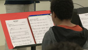Students reading sheet music in class (8 of 9). A view or scene of School stock video