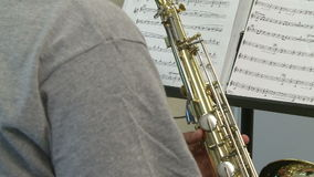 Students reading sheet music in class (1 of 9). A view or scene of School stock footage