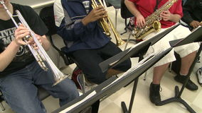 Students reading sheet music in class (7 of 9). A view or scene of School stock footage