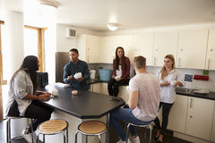 Students Relaxing In Kitchen Of Shared Accommodation royalty free stock image