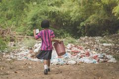 Students remove rubbish from the classroom to pile waste in school royalty free stock images