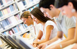 Students researching at the library Stock Image