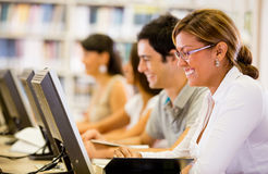 Students researching at the library Royalty Free Stock Photos