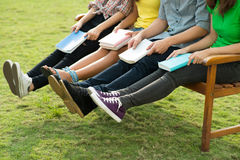 Students resting on bench Stock Images