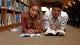 Students revising in the library stock video footage