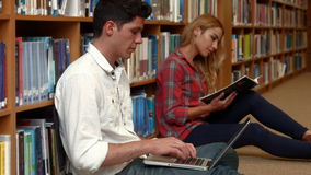Students revising in the library. At the college stock video footage