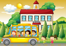 Students riding school bus to school Royalty Free Stock Image