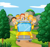 Students riding on yellow school bus Stock Photography