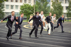 Students run. Funny students run celebrating graduation Belarus, Minsk