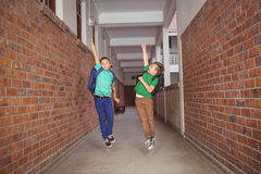Students running and jumping down the hall Royalty Free Stock Photography