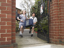Students Running Out Through School Gate Royalty Free Stock Photography