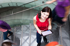 Students rushing up and down a busy stairway Stock Photo