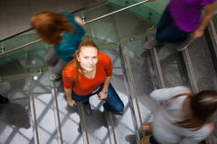 Students rushing up and down a busy stairway Stock Image