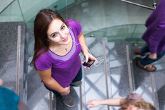 Students rushing up and down a busy stairway Stock Photography