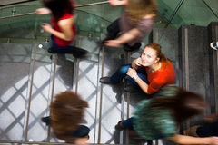 Students rushing up and down a busy stairway Stock Images