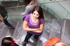 Students rushing up and down a busy stairway Royalty Free Stock Photo
