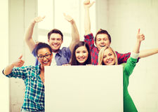 Students at school with blank white board Royalty Free Stock Photography