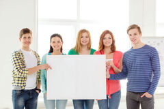 Students at school holding white blank board Royalty Free Stock Photos