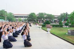 Students in a school is made obeisance before graduation. The statue of King Rama 8. That they respected. Royalty Free Stock Photos