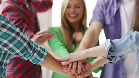 Students in school showing unity with their hands stock footage