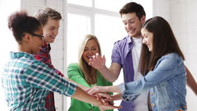 Students in school showing unity with their hands. Education and school - students showing unity with their hands together stock footage